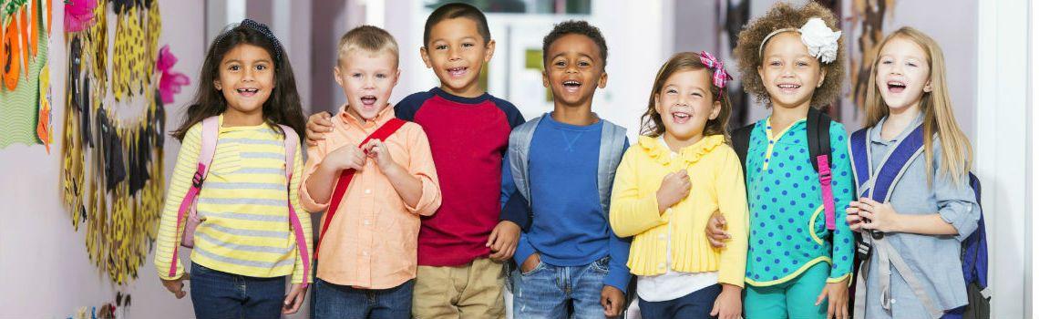 Smiling children in school hallway