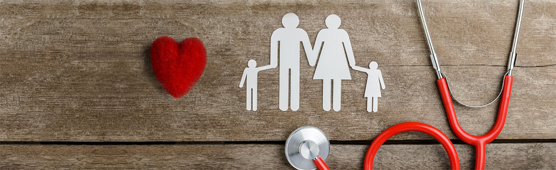 image of a heart and a paper cut-out of a family and a stethoscope