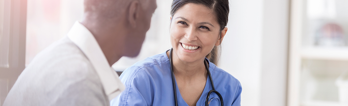 a health care provider talking to a patient