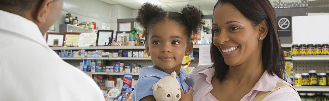 mother and daughter talking to pharmacist