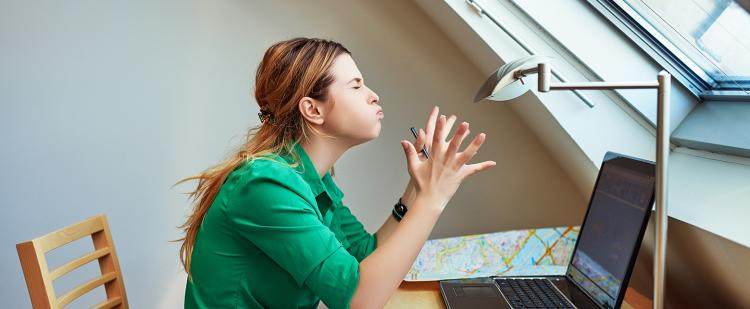 Woman stressed in front of computer