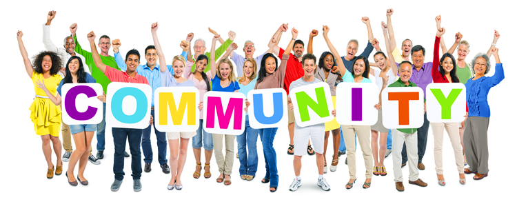 Group of people holding letters that spell community