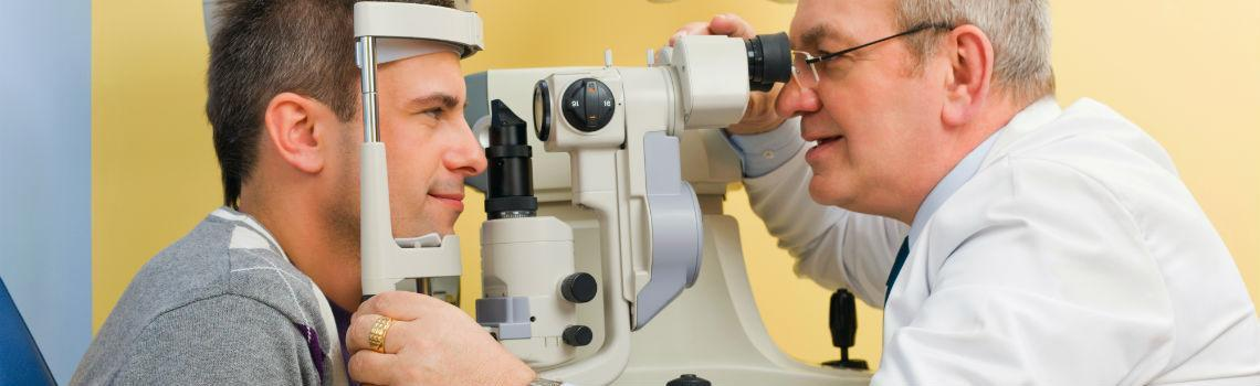 Optometrist giving eye exam