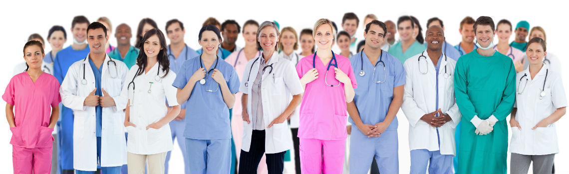 A large group of Health Care Professionals smiling at the camera