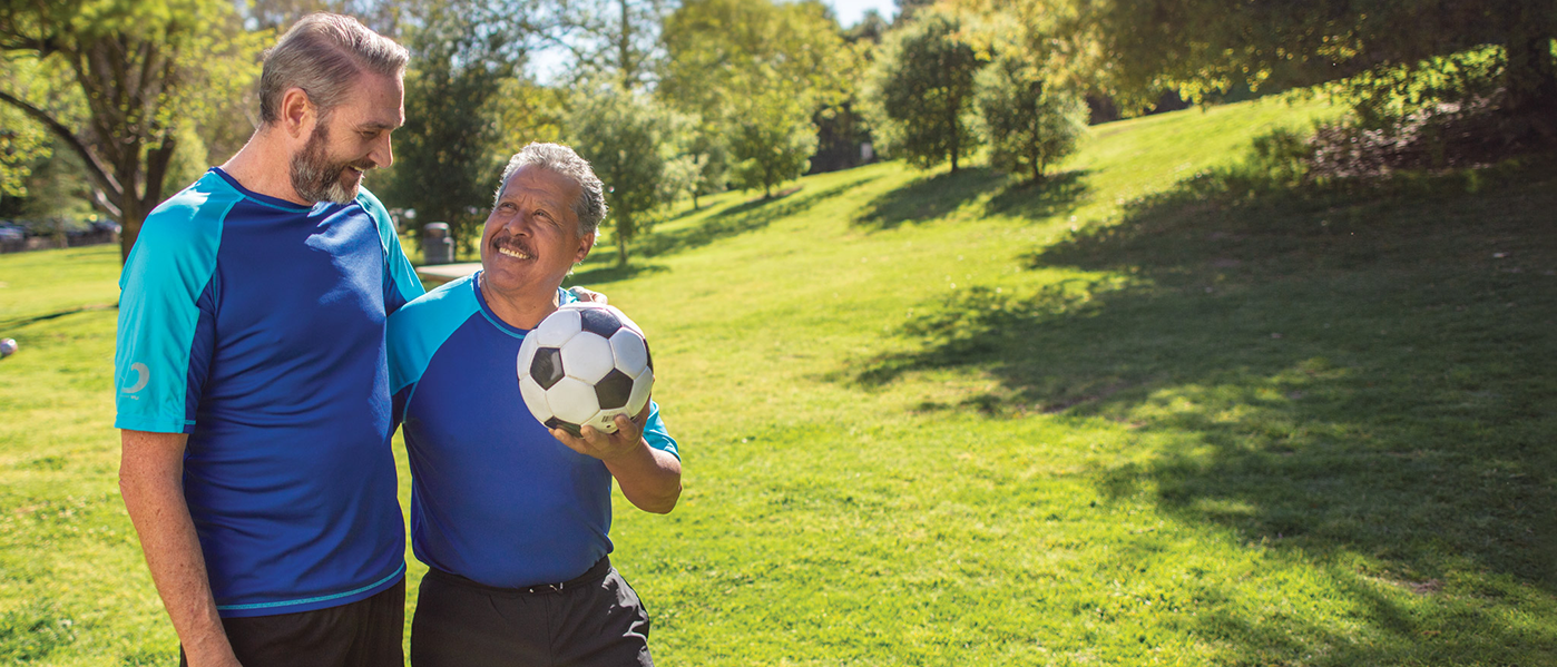 two men with soccer ball outdoors