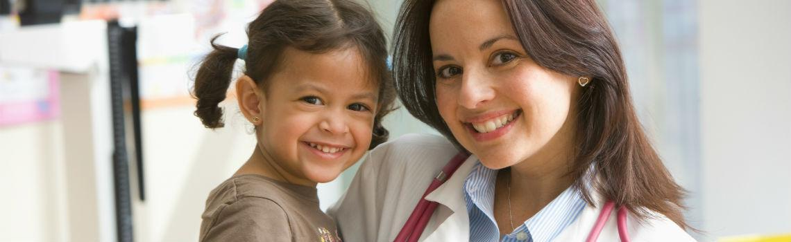 Doctor and child smiling